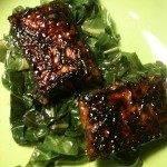 Orange-Balsamic Glazed Tempeh over Collard Greens